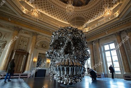 Visitors look at a work entitled 'Very Hungry God' by Indian artist Subodh Gupta as part of an exhibition of his work at the Monnaie de Paris, in Paris, France, 10 April 2018. The exhibition runs from 13 April to 26 August 2018.