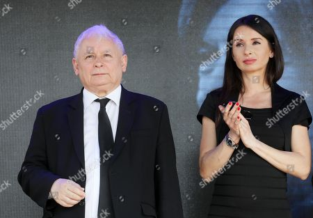 Leader of the Law and Justice (PiS) ruling party Jaroslaw Kaczynski (L) and his niece Marta Kaczynska (R) attend a ceremonies commemorating the eighth anniversary of the presidential plane crash near Smolensk at the Pilsudski Square in Warsaw, Poland, 10 April 2018. Poland's President Lech Kaczynski, his wife Maria Kaczynska and 94 others died on 10 April 2010 when Polish plane crashed in Smolensk, Russia.