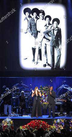Singers Mariah Carey and Trey Lorenz performing