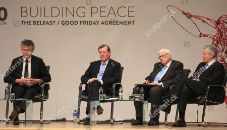 Jonathan Powell, Lord Trimble, Seamus Mallon and Peter Robinson sit on stage during a panel discussion at Queen's University in Belfast, northern Irland, Britain, 10 April 2018. Tuesday marks 20 years since politicians from Northern Ireland and the British and Irish governments agreed what became known as the Good Friday Agreement. It was the culmination of a peace process which sought to end 30 years of the Troubles. Two decades on, the Northern Ireland Assembly is suspended in a bitter atmosphere between the two main parties.