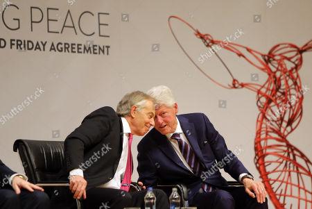Bill Clinton and George J. Mitchell