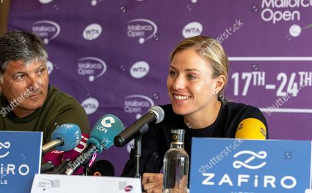 German tennis player Angelique Kerber (R) and tennis coach Toni Nadal (L) attend a press conference on occasion of the presentation of Mallorca Open tennis tournament in Palma de Mallorca, Balearic Islands, Spain, 10 April 2018. The third edition of Mallorca Tennis Open runs from 17 June until 24 June 2018 in Santa Ponsa.