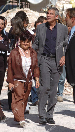 Stock Image of President of province Stefania Pezzopane, George Clooney and Mayor of L'Aquila Massimo Cialente
