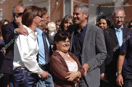 Editorial photo of George Clooney and Bill Murray visit the historical centre of L'Aquila, Italy - 09 Jul 2009
