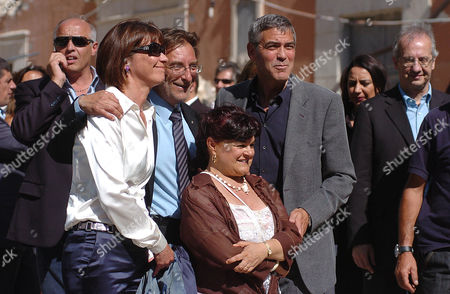 Mayor of L'Aquila Massimo Cialente with his wife (left), President of province Stefania Pezzopane and George Clooney