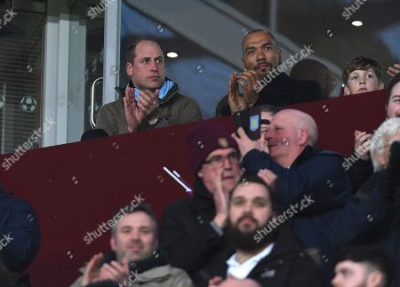 The Duke of Cambridge wearing an Aston Villa scarf and former Aston Villa player John Carew join in with a minute's applause in memory of Ray Wilkins before kick off