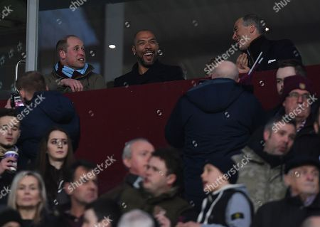 The Duke of Cambridge wearing an Aston Villa scarf takes his seat with former Aston Villa player John Carew before kick off