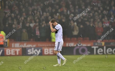 Grant Leadbitter of Middlesbrough looks dejected after being sent off by referee Darren Bond