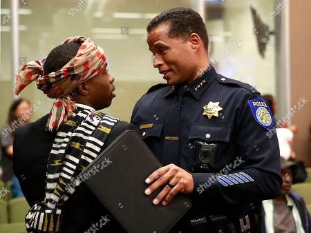 Stevante Clark, Daniel Hahn. Stevante Clark, the brother of Stephon Clark, who was shot and killed by Sacramento police, talks with Sacramento Police Chief Daniel Hahn before a meeting of the Sacramento City Council, in Sacramento, Calif. The Sacramento police have issued their first written policy on when officers can turn off body cameras after two officers muted their microphones after the fatal shooting of Stephon Clark, March 18