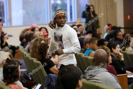 Stevante Clark, the brother of Stephon Clark, who was shot and killed by Sacramento police, leaves a meeting of the Sacramento City Council, in Sacramento, Calif. Clark asked to meet privately with Sacramento Mayor Darrell Steinberg and police Chief Daniel Hahn to discuss the shooting of his brother, who was unarmed when he was killed in the backyard of the his grandmother's home, on March 18