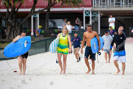 (L-R) Former Australian cyclist Anna Meares, Australian Paralympic skier and track and field athlete Jessica Gallagher and South African swimmer Chad le Clos prepare for a surf lesson with  Australian surfer Mick Fanning (R) during the XXI Commonwealth Games at Kirra Beach on the Gold Coast, Queensland, Australia, 11 April 2018.