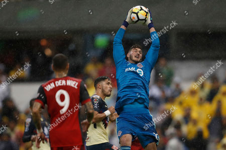 Stock Photo of Alexander Bono goalkeeper of Canada's Toronto FC, right, catches the ball during the second leg of a CONCACAF Champions League soccer semifinal against Mexico's America, in Mexico City