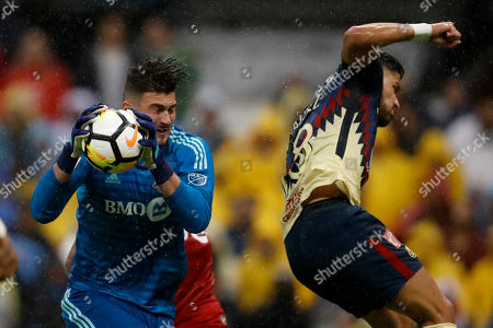 Alexander Bono goalkeeper of Canada's Toronto FC, left, catches the ball past Mateus Uribe of Mexico's America, during the second leg of a CONCACAF Champions League soccer semifinal in Mexico City, . The teams tied 1-1 and Toronto FC advanced on aggregate