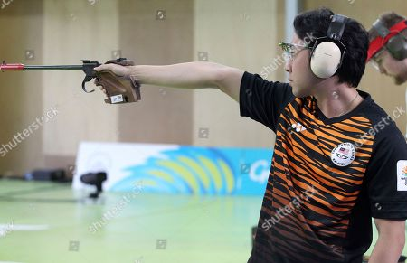 Stock Photo of Jonathan Wong of Malaysia shoots during the men's 50m Pistol final at the Belmont Shooting Centre during the 2018 Commonwealth Games in Brisbane, Australia