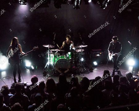 Nicole Eva Emery, Bradford Lee Conroy, Robbie Furze. British rock band The Big Pink opens for Wolf Alice at the Paradise Rock Club, in Boston. From left to right, are bass player Nicole Eva Emery, drummer Bradford Lee Conroy, and lead guitarist and vocalist Robbie Furze