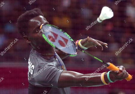 Uganda's Edwin Ekiring plays against England's Rajiv Ouseph during their men's singles badminton match at Carrara Sports Arena during the Commonwealth Games on the Gold Coast, Australia