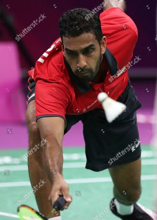 England's Rajiv Ouseph plays against Uganda's Edwin Ekiring during their men's singles badminton match at Carrara Sports Arena during the Commonwealth Games on the Gold Coast, Australia