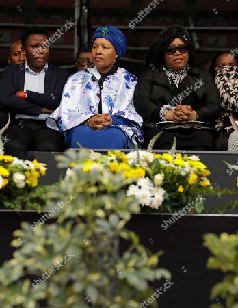 Daughters of anti-apartheid activist Winnie Madikizela-Mandela, Zenani and Zindzi Mandela, second and third from left, attend their mother's memorial service at Orlando, Stadium, in Soweto, South Africa, . Madikizela-Mandela died on April 2 at the age of 81 after a long illness