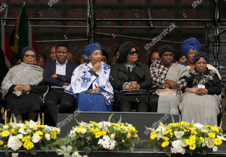 Daughters of anti-apartheid activist Winnie Madikizela-Mandela, Zenani and Zindzi Mandela, third and fourth from left, attend their mother's memorial service at Orlando, Stadium, in Soweto, South Africa, . Madikizela-Mandela died on April 2 at the age of 81 after a long illness