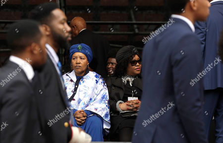 Daughters of anti-apartheid activist Winnie Madikizela-Mandela, Zenani, left, and Zindzi Mandela, attend their mother's memorial service at Orlando, Stadium, in Soweto, South Africa, . Madikizela-Mandela died on April 2 at the age of 81 after a long illness