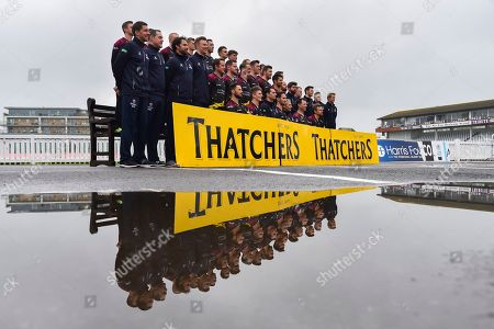 Somerset players wearing the Vitality Blast kit and coaches team photo reflected in a puddle.  (Back Row) Tim Rouse, Eddie Byrom, Fin Trenouth, Ollie Sale, Paul van Meekeran, Ben Green, Tom Banton, George Bartlett, Josh Davey, Johann Myburgh, (Middle Row) James Alway, Gary Metcalf, Steve Snell, Greg Kennis, Roelof van der Merwe, Steve Davies, Max Waller, Craig Overton, Jamie Overton, Tim Groenewald, Jack Leach, Jamie Thorpe, Joel Tratt, Andrew Griffiths, Paul Tweddle, James Kennedy, (Front Row) Peter Trego, Lewis Gregory, Jason Kerr, Tom Abell, Andy Hurry, Marcus Trescothick and James Hildreth at the media day at Somerset County Cricket Club at the Cooper Associates County Ground, Taunton. Picture by Graham Hunt