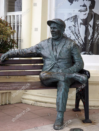 Bronze statue of film actor and comedian Sir Norman Wisdom OBE outside the Sefton Hotel, Douglas, Isle of Man. The bar at the hotel is called 'Sir Norman's' and there is a collection of photographs of him and film posters on display there. He died 4th October 2010.