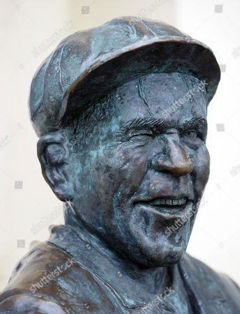 Stock Image of Bronze statue of film actor and comedian Sir Norman Wisdom OBE outside the Sefton Hotel, Douglas, Isle of Man. The bar at the hotel is called 'Sir Norman's' and there is a collection of photographs of him and film posters on display there. He died 4th October 2010.