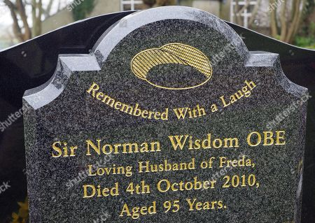 Stock Picture of Grave of film actor and comedian Sir Norman Wisdom OBE at St Bridget church (Bride parish church) Isle of Man. He died 4th October 2010 at a nursing home Rushen, Isle of Man