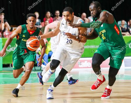 Kieron Achara (C) of Scotland under pressure from Cameroon defenders Robert Songolo Ngijol (L) and Simon Bileg II (R) during the Mens Preliminary Round Pool B Basketball, Scotland v Cameroon, of the XXI Commonwealth Games at the Townsville Entertainment Centre, Townsville, Australia, 07 April 2018.