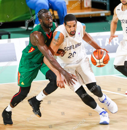 Kieron Achara (R) of Scotland heads up the court with Cameroon defender Arnold Akola Kome hot on his heels during the Mens Preliminary Round Pool B Basketball, Scotland v Cameroon, of the XXI Commonwealth Games at the Townsville Entertainment Centre, Townsville, Australia, 07 April 2018.