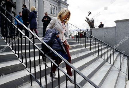 Attorney Lisa Bloom walks out of the Montgomery County Courthouse during a break in Bill Cosby's sexual assault trial, in Norristown, Pa