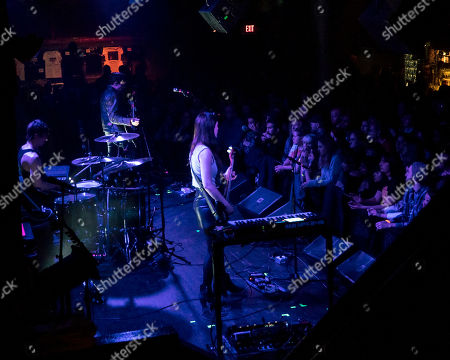 Bradford Lee Conroy, Robertson Furze, Nicole Emery. The British rock band The Big Pink performs as the opener for Wolf Alice at the Paradise Rock Club, in Boston. From left to right are drummer Bradford Lee Conroy, guitarist Robertson Furze, and bass player Nicole Emery