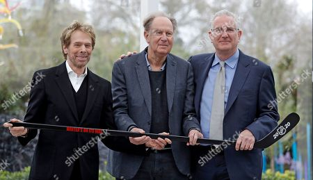 Tod Leiweke, David Bonderman, Jerry Bruckheimer. Part owners Jerry Bruckheimer, left, and David Bonderman, center, pose with Tod Leiweke and a hockey stick during a news conference naming Leiweke as the president and CEO for a prospective NHL expansion team, in Seattle. Leiweke is the brother of Tim Leiweke, the CEO of the group heading the redevelopment of the arena which would serve as a home for a new hockey team. The group is seeking to have a team awarded in time to begin play in 2020