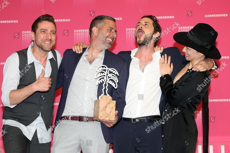 Stock Photo of Israeli actor Moshe Ashkenazi (L), Israeli director Omri Givon (2-L), Israeli actors Tomer Capon (2-R) and Ninet Tayeb (R) pose during the award winners photocall after they won the Best Series award for the TV series 'When Heroes Fly' at the 1st Cannes International Series Festival, in Cannes, 11 April 2018. The festival runs from 04 to 11 April.