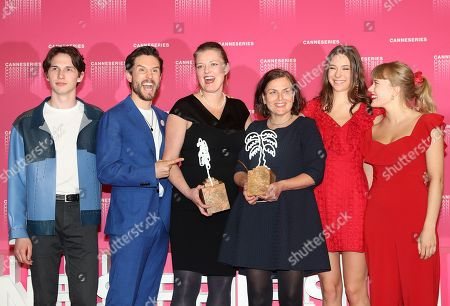 Norwegian actor Amund Harboe (L), British actor Bart Edwards (2-L), Norwegian producer Synnove Horsdal (3-L), Norwegian writer Mette Bolstad (3-R), actresses Anne Regine (2-R) and Malene Wadel (R) pose during the Award Winners photocall after they won the Best Screenplay award for the TV series  'State Of Happiness' at the 1st Cannes International Series Festival, in Cannes, 11 April 2018. The festival runs from 04 to 11 April.