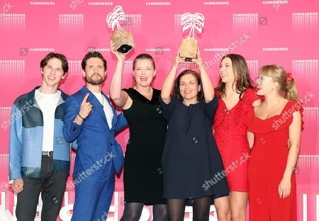 Stock Photo of Norwegian actor Amund Harboe (L), British actor Bart Edwards (2-L), Norwegian producer Synnove Horsdal (3-L), Norwegian writer Mette Bolstad (3-R), actresses Anne Regine (2-R) and Malene Wadel (R) pose during the Award Winners photocall after they won the Best Screenplay award for the TV series  'State Of Happiness' at the 1st Cannes International Series Festival, in Cannes, 11 April 2018. The festival runs from 04 to 11 April.