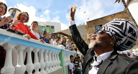 Brazilian artist Carlinhos Brown (R) and Ibero-American General Secretary, Rebeca Grynspan (C) attend an event where Brown received the title of Ibero-American Ambassador of Culture, in the neighborhood of Candeal, Salvador de Bahia, Brazil, 11 April 2018.
