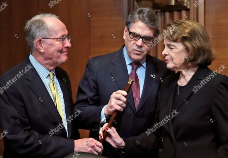 Dianne Feinstein, Lamar Alexander, Rick Perry. Chairman Lamar Alexander, R-Tenn., left, Energy Secretary Rick Perry, and Sen. Dianne Feinstein, D-Calif., look at a cane that once belonged to Sam Houston that is now owned by Alexander, before Perry testifies on the FY2019 budget during a hearing of the Senate Appropriations Committee Subcommittee on Energy and Water Development on Capitol Hill, in Washington