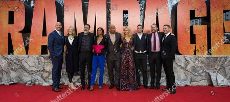 Hiram Garcia, Wendy Jacobson, Jeffrey Dean Morgan, Naomie Harris, Dwayne Johnson, Malin Akerman, Brad Peyton, Beau Flynn, John Rickard. Hiram Garcia, Wendy Jacobson, Jeffrey Dean Morgan, Naomie Harris, Dwayne Johnson, Malin Akerman, Brad Peyton, Beau Flynn and John Rickard pose for photographers upon arrival at the premiere of the film 'Rampage', in London