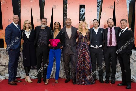 Stock Image of Hiram Garcia, Wendy Jacobson, Jeffrey Dean Morgan, Naomie Harris, Dwayne Johnson, Malin Akerman, Brad Peyton, Beau Flynn, John Rickard. Hiram Garcia, Wendy Jacobson, Jeffrey Dean Morgan, Naomie Harris, Dwayne Johnson, Malin Akerman, Brad Peyton, Beau Flynn and John Rickard pose for photographers upon arrival at the premiere of the film 'Rampage', in London