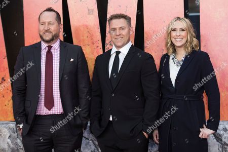 Producer Beau Flynn, Producer John Rickard, Associate Producer Wendy Jacobson. Producer Beau Flynn, Producer John Rickard and Associate Producer Wendy Jacobson pose for photographers upon arrival at the premiere of the film 'Rampage' in London