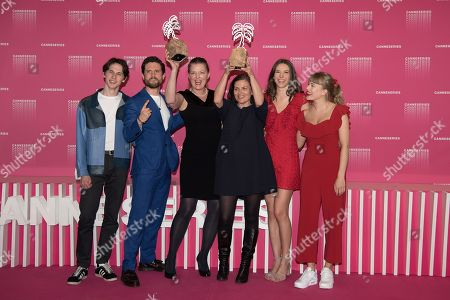Amund Harboe, Bart Edwards, Synnove Horsdal, Mette Bolstad, Anne Regine Ellingsaeter and Malene Wadel pose with the Best Screenplay and Best Original Score awards for the serie 'State of Happiness'