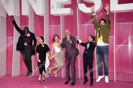 Stock Picture of Official competition jury members Michael K Williams, Melisa Sozen, Paula Beer, Harlan Coben, Audrey Fouche and Cristobal Tapia De Veer jump on the pink carpet