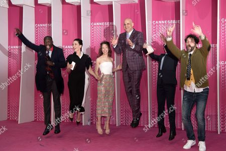 Official competition jury members Michael K Williams, Melisa Sozen, Paula Beer, Harlan Coben, Audrey Fouche and Cristobal Tapia De Veer jump on the pink carpet