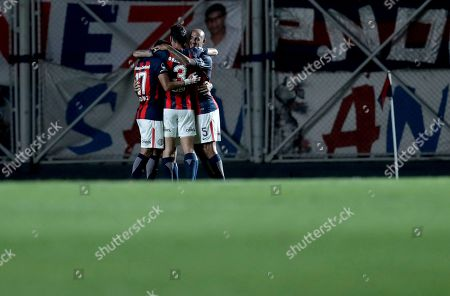 Argentina's San Lorenzo Gabriel Alejandro Gudino celebrates after scoring against Brazil's Atletico Mineiro with teammates during a Copa Sudamericana soccer match in Buenos Aires, Argentina