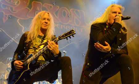 Lead singer Biff Byford and guitarist Doug Scarratt of the band Saxon performs at the Resch Center in Green Bay, Wisconsin