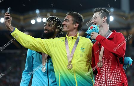 Stock Photo of Stephanie McPherson,Amantle Montsho, Anastasia Le Roy. Men's high jump gold medalist Australia's Brandon Starc, centre, stands with silver medalist Jamal Wilson of the Bahamas, left, and bronze medalist Canada's Django Lovett as they take a selfie photo on the podium at Carrara Stadium during the 2018 Commonwealth Games on the Gold Coast, Australia