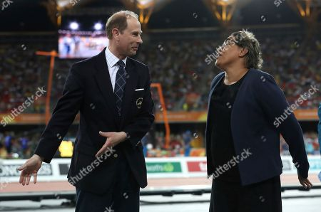 Duke of Wessex, Prince Edward, and Cathy Freeman wait to present the medals to the women's 400m winners at Carrara Stadium during the 2018 Commonwealth Games on the Gold Coast, Australia