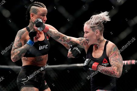 Bec Rawlings, Ashlee Evans-Smith. Bec Rawlings, right, punches Ashlee Evans-Smith, left, during the first round of a women's flyweight mixed martial arts bout at UFC 223, in New York. Evans-Smith won the fight