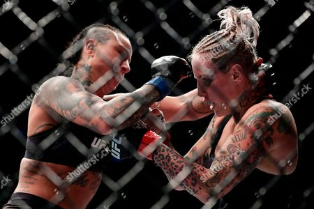 Stock Image of Bec Rawlings, Ashlee Evans-Smith. Ashlee Evans-Smith, left, punches Bec Rawlings, right, of Australia, during the second round women's flyweight mixed martial arts bout at UFC 223, in New York. Evans-Smith won the fight